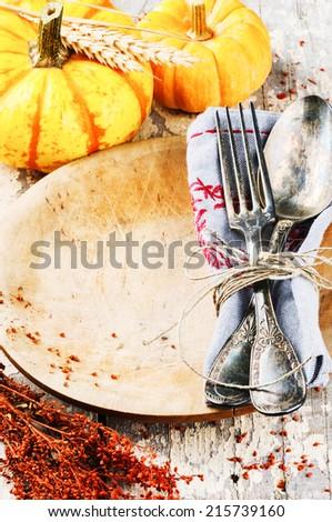 Seasonal table setting with decorative pumpkins  - stock photo