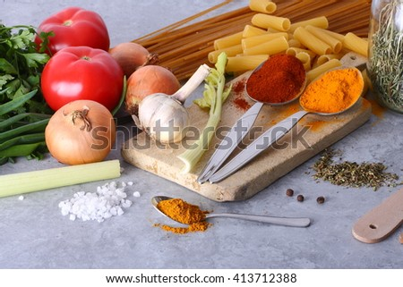 Seasonal table with pasta and spices background. - stock photo