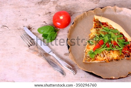 Seasonal table with pizza and cutlery. - stock photo