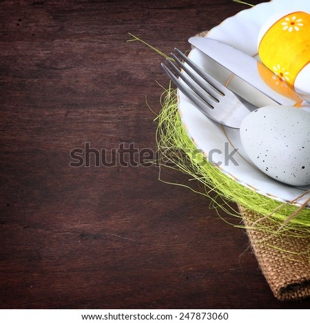 seasonal wooden easter table with cutlery  - stock photo