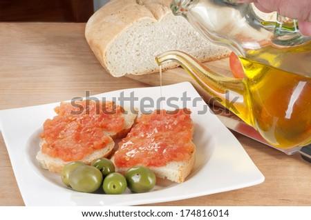 seasoned bread with tomato - stock photo