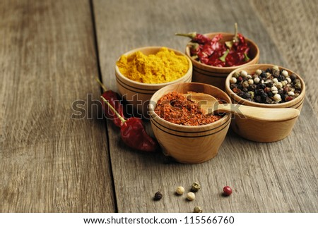 Seasonings and some jalapenos on the wooden table - stock photo