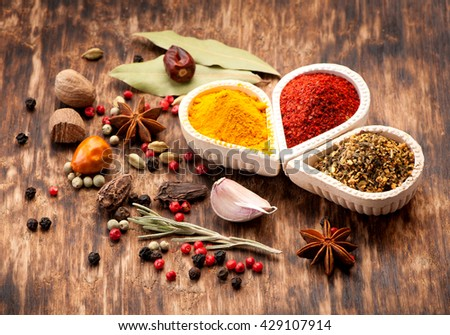 Seasonings, spices on a wooden background