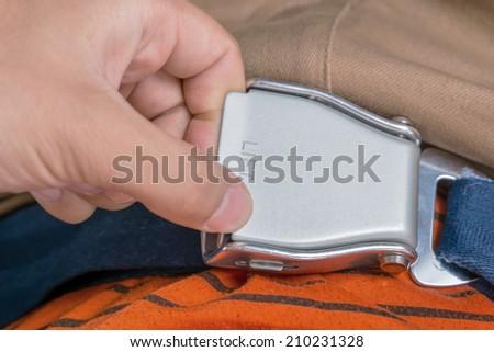 seat belt in plane - stock photo