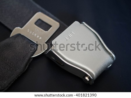 Seat belt on an airplane. - stock photo