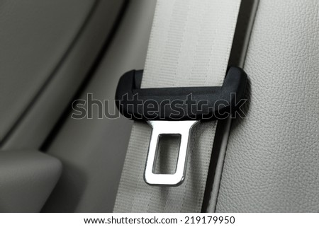 Seat belt on leather chair - stock photo