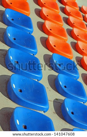 seat to sit and attend races and football matches at the stadium - stock photo