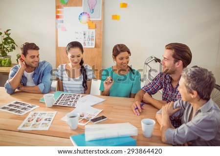 Seated creative business team working together in the office - stock photo