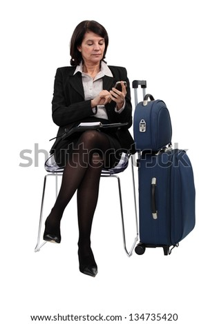 Seated Woman with suitcases - stock photo