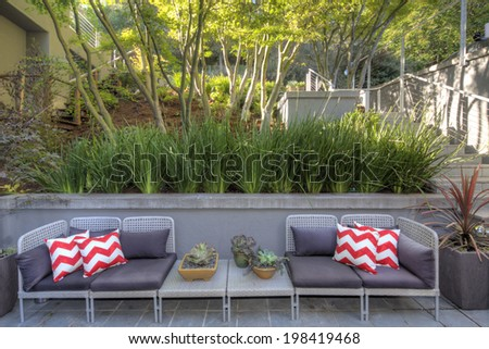 Seating arrangement of hillside home with, garden and zigzag decorative pillows.   - stock photo