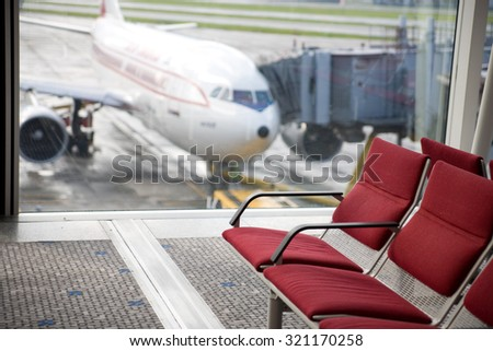 Seating at the departure gate of an airport - stock photo
