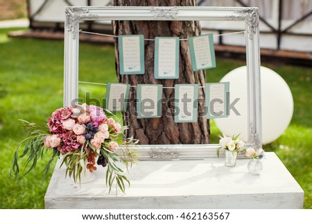 seating map in silver frame and flowers