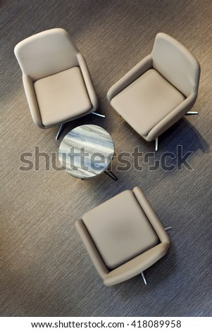 Seats and small table in a room - stock photo