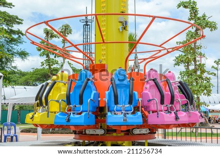 Seats of free fall tower in amusement park - stock photo