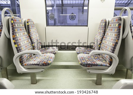 Seats on a train, detail of a new public transport, modernity and progress - stock photo
