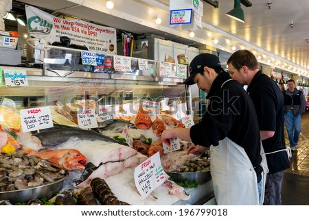 SEATTLE-APR 13, 2014:Pike Place Market fishmongers prepare the daily catch in the morning before shoppers arrive. There are four fish vendors at the historic marketplace featuring fresh local seafood. - stock photo