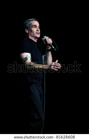 SEATTLE - APRIL 6:  Spoken word artist, rock star, singer, movie star, actor, poet, activist Henry Rollins speaks on stage at the Triple Door Theater in Seattle, WA on April 6, 2011.