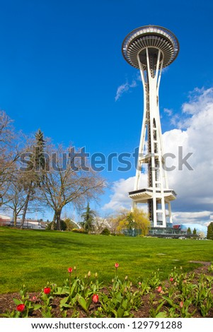 SEATTLE-APRIL 4: The Space Needle with flower beds of seasonal spring tulips in Seattle on April 4, 2012. The iconic structure celebrates its 50th anniversary in 2012. - stock photo