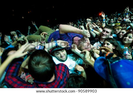 SEATTLE, DECEMBER 7, 2011:  Lead Singer Matt Shultz of alternative rock band Cage the Elephant surfs the sold out crowd at Key Arena during the Deck the Hall Ball in Seattle on December 7, 2011.