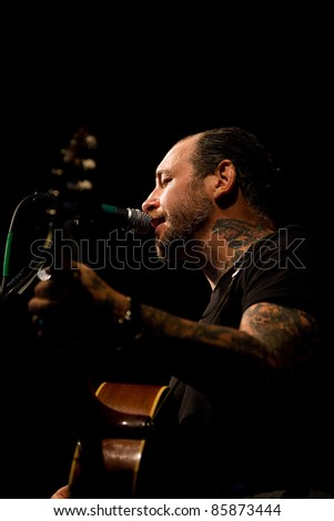 SEATTLE - FEB 13:  Mike Ness of rock band Social Distortion sings and plays guitar on stage at the Crocodile in Seattle on February 13, 2011.