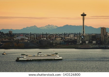 Seattle Ferry and the Space Needle. A Seattle super ferry makes its way across Elliott Bay headed toward Bainbridge Island. - stock photo