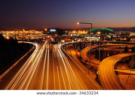 Seattle freeways with colorful streaks of light from fast moving traffic - stock photo