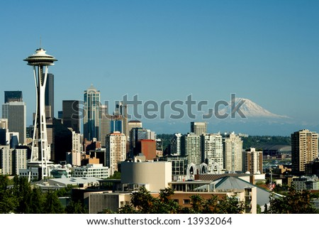 Seattle from Queen Anne is a view of the Seattle Space Needle and Mt. Rainier in this traditional post card view. - stock photo