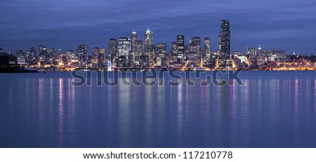 Seattle from the West Side as night falls with a storm moving in