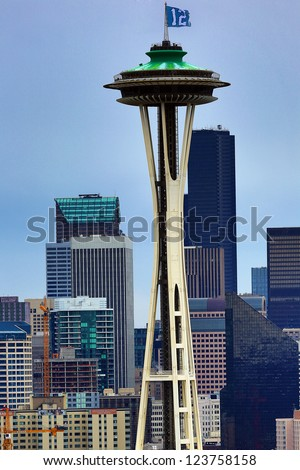 SEATTLE - JANUARY 6,:  The space needle in downtown Seattle, Washington with the Seattle Seahawks 12th man flag representing the fans of the NFL team on January 6, 2013. - stock photo