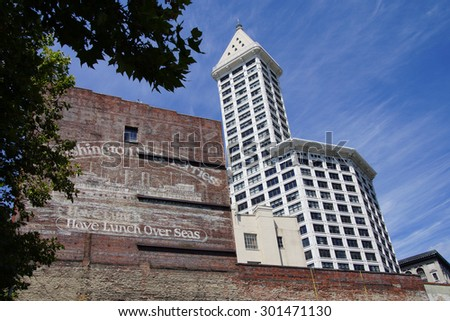 SEATTLE - JUL 23, 2015 - The Smith Tower rises above old brick building near Pioneer SquareSeattle, Washington - stock photo