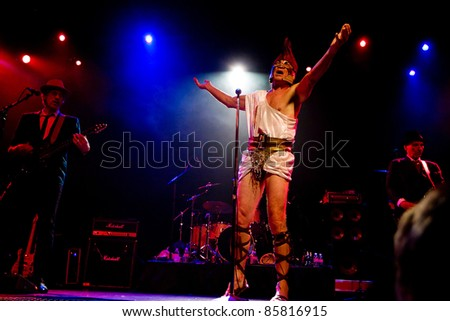 SEATTLE - JULY 1:  Lead singer Fee Waybill of the classic rock band The Tubes performs on stage dressed as a Roman Gladiator at the Triple Door Theater in Seattle on July 1, 2011.