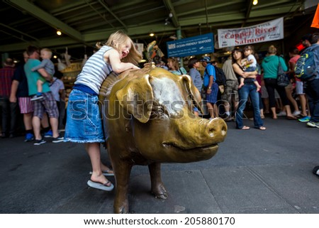 SEATTLE - JULY 5: Pike Place Market's unofficial mascot, Rachel on July 5, 2014 A bronze cast piggy bank that weighs 550 pounds, has been located since 1986 at the corner of Pike Place Market. - stock photo