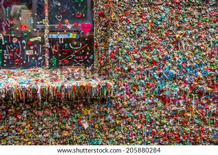 SEATTLE- JULY 5 : The Market Theater Gum Wall in downtown Seattle on July 5, 2014. It is a local landmark in downtown Seattle, in Post Alley under Pike Place Market.  - stock photo
