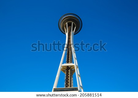 SEATTLE - JULY 5:  The Space Needle in Seattle on July 5, 2014. A symbol of Seattle. It was built in the Seattle Center for the 1962 World's Fair. - stock photo