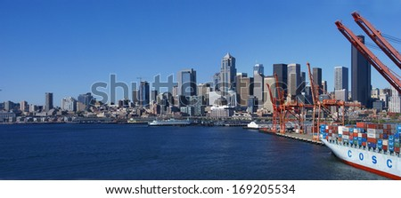 SEATTLE - JUN 27, 2008 - Container ship and dockyard cranes, .Puget Sound, .Pacific Northwest.. - stock photo