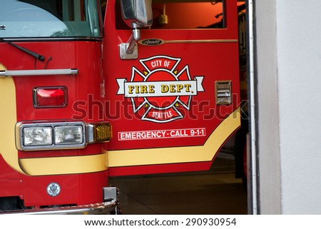 SEATTLE - JUNE 24, 2015 - Open door of a Seattle Fire Dept. truck, showing the department is ready at a moments notice to respond to an emergency. - stock photo