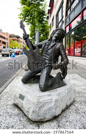 SEATTLE - MAY 9: A bronze statue of Jimi Hendrix stands in the Capitol Hill neighborhood on May 9, 2014 in Seattle. - stock photo