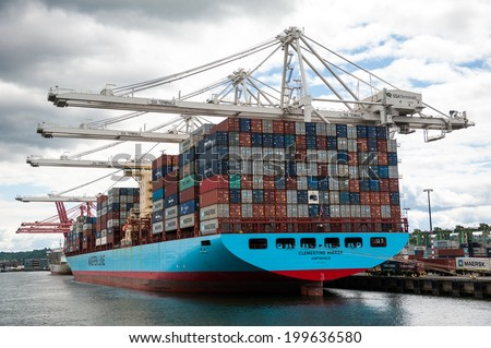 SEATTLE - MAY 10: A Maersk Line freighter is docked on Harbor Island in Seattle, Washington on May 10, 2014. - stock photo