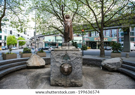 SEATTLE - MAY 10 - A statue of Chief Seattle stands in the center of Tilikum Place plaza in Seattle seen on May 10, 2014. - stock photo