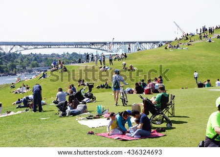 SEATTLE - MAY 30, 2016 - Dozens of people celebrate a relaxing Memorial Day at Gas Works Park