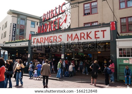 SEATTLE - MAY 18: Pike Place Public Market entrance on May 18, 2007 in Seattle. Market opened in 1907 and is one of oldest continually operated public markets in US, with 10 million visitors a year. - stock photo