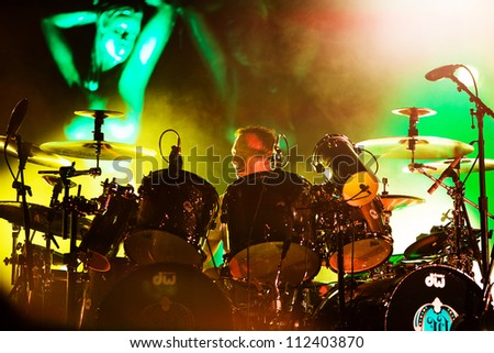 SEATTLE - SEPTEMBER 1, 2012:  Drummer Stephen Perkins of rock band Jane's Addiction performs on the main stage at Key Arena during the Bumbershoot music festival in Seattle, WA on September 1, 2012 - stock photo