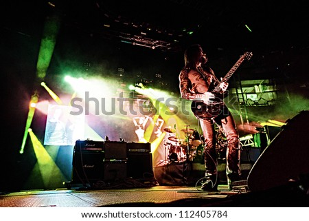 SEATTLE - SEPTEMBER 1, 2012:  Guitarist Dave Navarro of rock band Jane's Addiction performs on the main stage at Key Arena during the Bumbershoot music festival in Seattle, WA on September 1, 2012 - stock photo