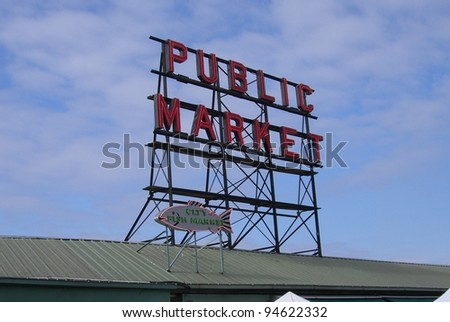 SEATTLE - SEPTEMBER 15: Neon sign of the Pike Place Market on September 15, 2007 in Seattle, Washington. The market opened in 1907 and is still a major tourist attraction in Seattle. - stock photo