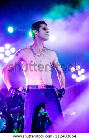 SEATTLE - SEPTEMBER 1, 2012:  Singer Perry Farrell of rock band Jane's Addiction performs on the main stage at Key Arena during the Bumbershoot music festival in Seattle, WA on September 1, 2012 - stock photo