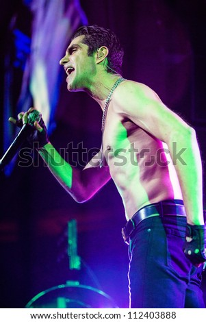SEATTLE - SEPTEMBER 1, 2012:  Singer Perry Farrell of rock band Jane's Addiction performs on the main stage at Key Arena during the Bumbershoot music festival in Seattle on September 1, 2012. - stock photo