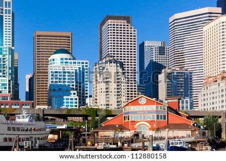 Seattle skyline and waterfront at Pier 55, viewed from the water. - stock photo