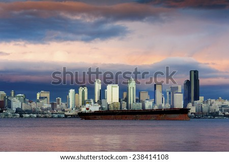 Seattle Skyline at Sunset. The view across Elliott Bay from West Seattle during a lovely winter sunset. Seattle, Washington, USA. - stock photo