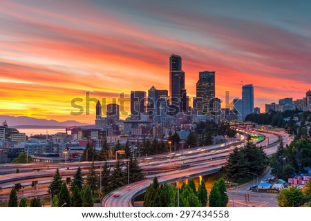 Seattle skylines and highway traffic motion in the sunset. The view from Rizal Park in Seattle, Washington, US. City scape and high speed concept. - stock photo