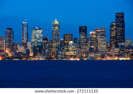 Seattle skylines in blue hour, view from Alki Beach - stock photo